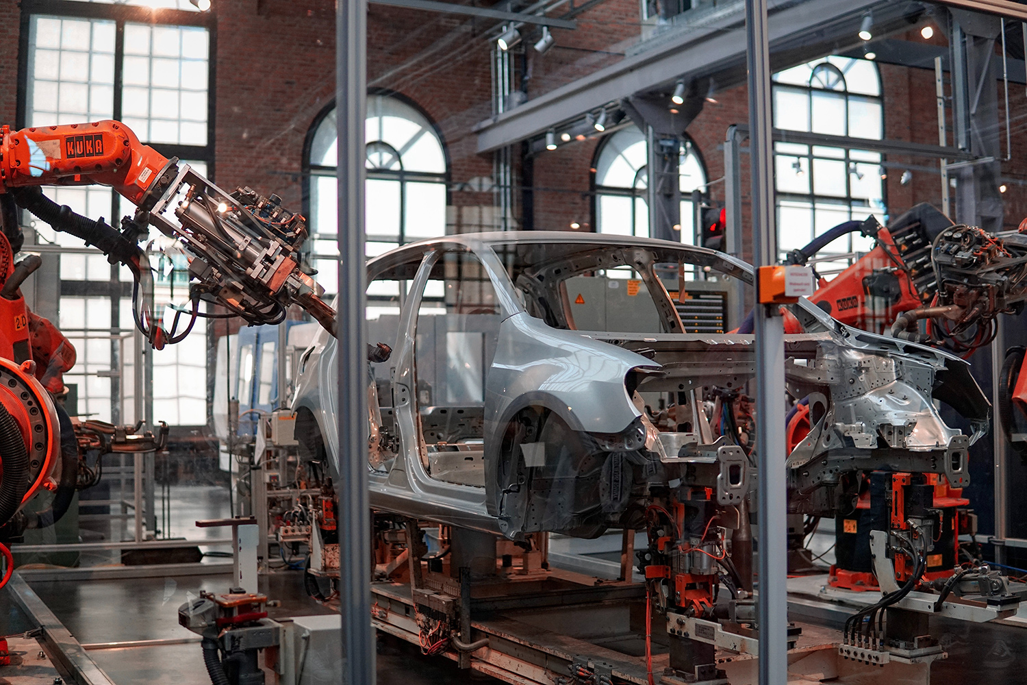 Robots building body of a car
