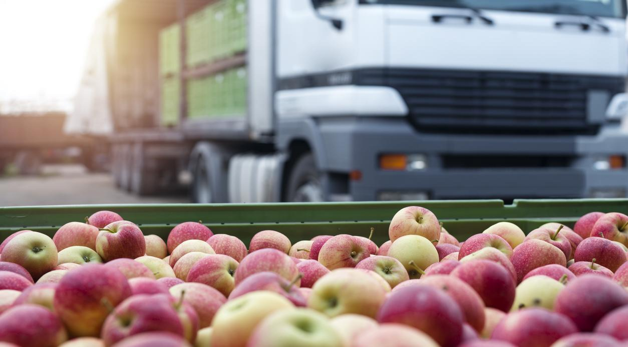 tub of apples with truck in background