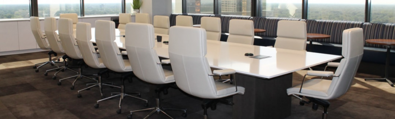 White chairs at a desk.