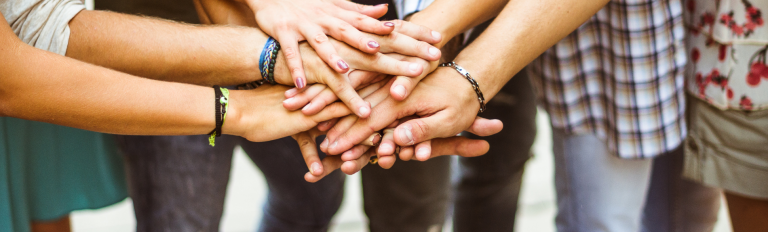 Hands in together as a team.